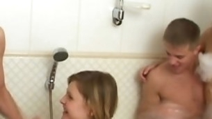 Two horny legal age teenager couples are having unforgettable foursome fucking in a baths