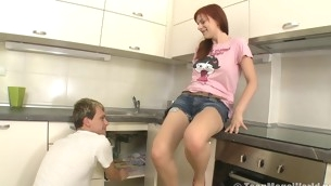 Fiery redhead enjoys animal banged in the kitchen